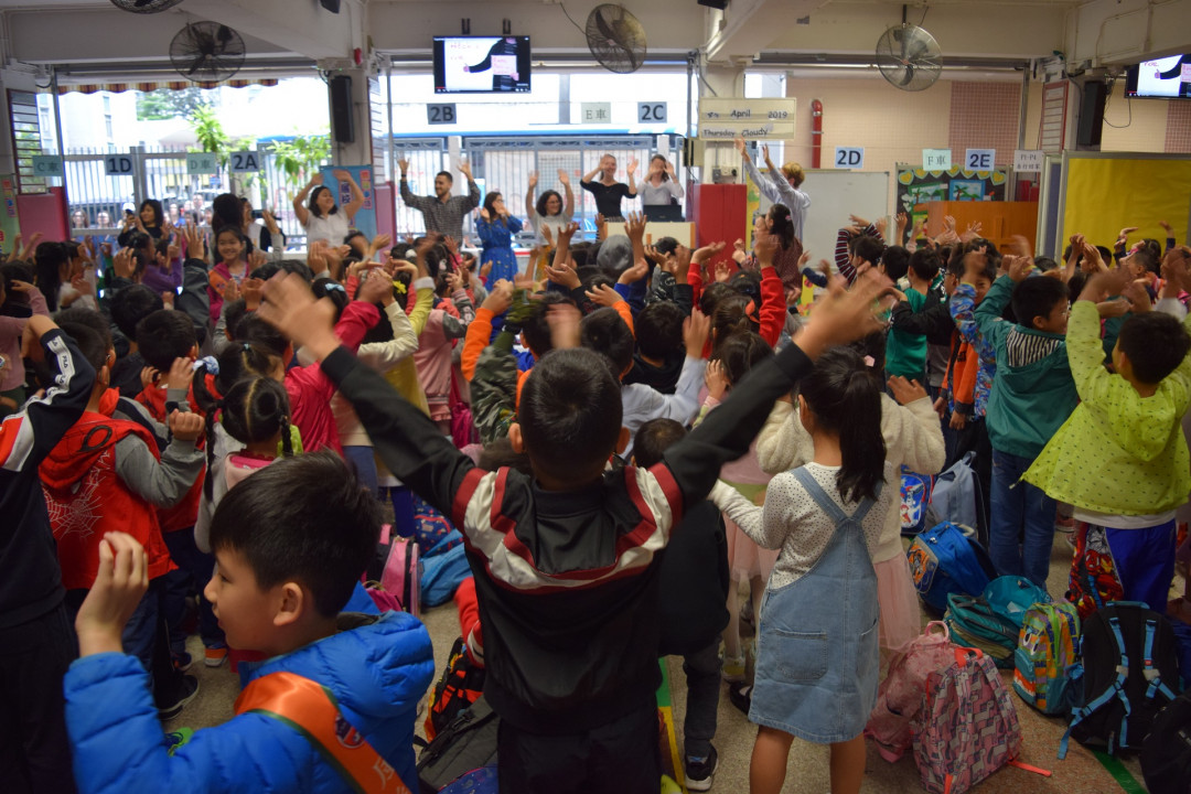 Students enjoy the morning assembly held by the 9 NETs on English Day.